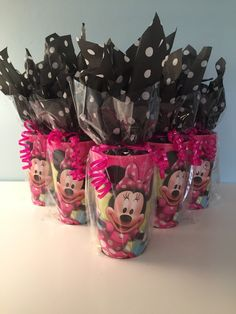 SET OF 12 MINNIE MOUSE THEMED PARTY FAVORS. EACH FAVOR INCLUDES A 22 OZ. MINNIE CUP, BEADED NECKLACE, MINNIE RING, (2) STICKERS, BOX OF 8 MINNIE
