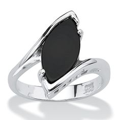 The elegant profile of this unique ring lends a regal touch your wardrobe. The marquise-cut onyx stone sits just askew i-tXTT2u54