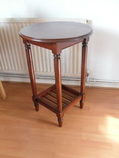 Side table with turned legs and round top