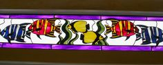 Image detail for -Tropical fish in stained glass along the sides of the Endangered Species Carousel at Turtle Back Zoo in West Orange NJ.