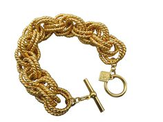 This attractively, modern bracelet is crafted from a chunky, woven golden chain with a twisted design that will bring chic flair to your look. The bracelet closes with a toggle clasp. #stuff4uand4u