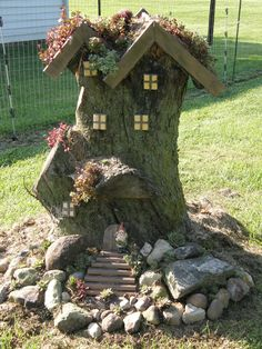 About two weeks ago, I shared our gnome home. Here is an updated photo. We have found a gnome and given him a front yard makeover. Still working on the sides and back yard. :-)