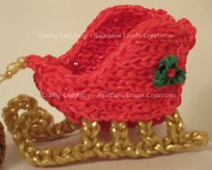 By Crafty Ladybug - Rainbow Loom Creations. SLEIGH. Click on photo for pictorial. This is an advanced design requiring 4 looms.