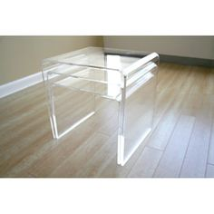 I love these acrylic end tables. I will put one by my bed. I can see it now