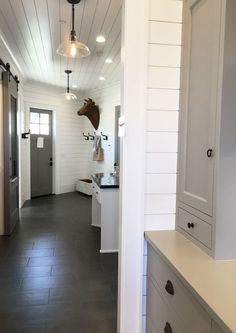 Street of Dreams Mudroom - White Shiplap and Gray Tile Floors