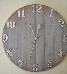 DIY rustic clock. Looks like you could make this with pieces of pallet wood, or simply go to the Home Depot and have them cut the pieces for you. Add metal numbers, and you've got yourself a fabulous wall clock!!