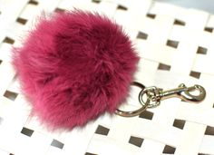 Marsala pom pom keychain, purple pom pom, leather tassel keychain, fur pom pom, Fur Puff, Hand bag charm, Purse clip, Marsala color by PetalleCreations on Etsy https://www.etsy.com/listing/193789872/marsala-pom-pom-keychain-purple-pom-pom