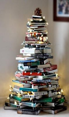 definitely want to incorporate books into my decor, fits the cosy theme. not necessarily in this way but cute idea even for my bedroom ?? use christmas books.