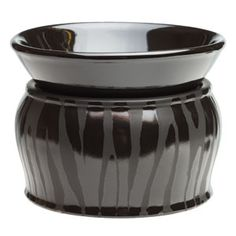 A dramatic take on traditional zebra, this all-black warmer showcases contrasting shiny and matte stripes.
