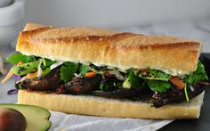 The amazing sandwich is loaded tons of vegetables and marinated portobello mushrooms.