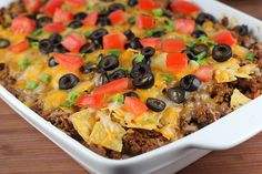 Mexican Casserole Prep time: 20 minutes Cook time: 10 minutes Ingredients: ground beef 1 ¼ ounce) package taco seasoning 1 ounce) can refried beans 2 cups Colby jack cheese 1 cup salsa 1 tomato (chopped) 2 cups corn chips (crushed) Think Food, I Love Food, Good Food, Yummy Food, Mexican Dishes, Mexican Food Recipes, Beef Recipes, Cooking Recipes, Mexican Pizza