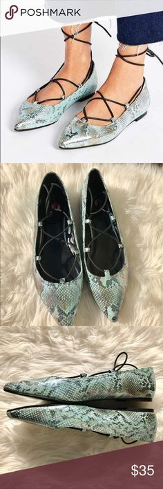 Asos Snake Print Laceup Flats Size 9 Asos Snake Print Lace up Flats Size 9. Soft exterior with Snake patterned design, and a holographic finish. Lace closure. Pointed toe cap with a flat sole. Good condition. See pictures. No trades. ASOS Shoes Flats & Loafers