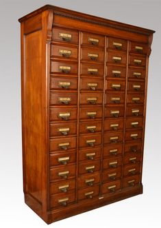 Antique Filing Cabinets, Walnut Forty Eight Draw Shannon Filing Cabinet. Edwardian Walnut forty eight draw Shannon filing cabinet with moulded top and foliate carved frieze, above forty eight panelled drawers with metal handles, on plinth Drawer Shelves, Storage Cabinets, Book Shelves, Unique Furniture, Rustic Furniture, Library Cabinet, Computer Armoire, Apothecary Cabinet, Antique Cabinets