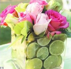 Fruit & Flower Bouquet ~ Arrange sliced limes and/or lemons...add pink and fuchsia roses. Great combo!