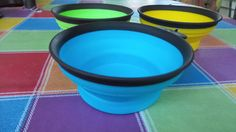 The brightly colored dog bowls are sold as a 3 pack, on Amazon from Comsum.   These bowls are portable and made from Eco friendly material.  These bowls are constructed with food grade silicone.  They are durable,reusable and stack nice for easy storage.