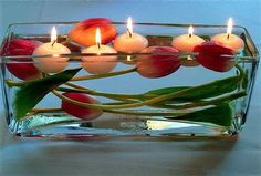 Love the submerged tulips and floating candles in the longer low glass vase.