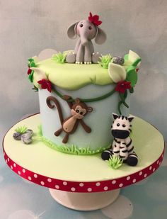 Mini jungle birthday cake with elephant, monkey and zebra