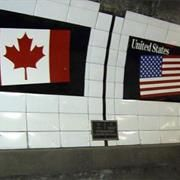 This is down inside the tunnel at the bottom of the Detroit River, connecting Canada and Detroit.   You can see the line that separates the two countries.