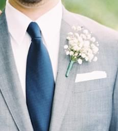 The other boutonnieres will be white baby's breath wrapped in a band of emerald green ribbon.