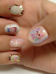 """.I really like the thumb and middle fingers """"Mother Pearl"""" look to the nail, and the natural flesh tone color of the ring finger."""