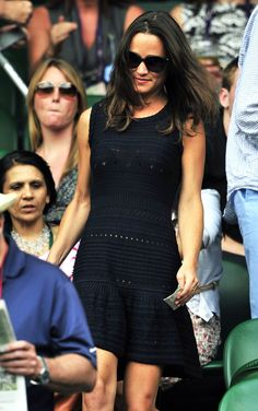 July 2011 - She knows how to rock a summer dress. Here she is attending the semifinals at Wimbledon