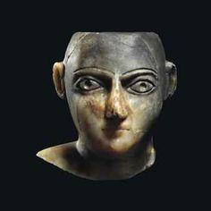 A SOUTH ARABIAN ALABASTER HEAD CIRCA 1ST CENTURY B.C.- 1ST CENTURY A.D.