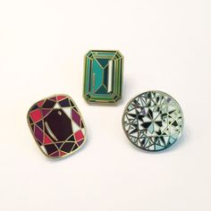 1 Ruby, 1 Diamond, and 1 Emerald 1 lapel pins  Ruby: 1 x 0.88 inch (2.6 x 2.1 cm)  Diamond: 1 x 1 inch (2.6 x 2.6 cm)  Emerald: 1 x 0.75 inch (2.6 x 1.9 cm)  All pins are made with shiny, top quality, hard enamel. Emerald and Ruby have gold-toned high polished metal finish. Diamond has silver-toned high polished metal finish. Each pin has one pin on the back with metal clutch backing. Packaged on a Diamondoodles card and sealed in a cellophane bag. **NOTE: Images featuring other pins and…