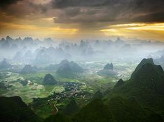 Yangshuo, China: A hot air balloon captures the dreamland scenery of Yangshuo, China, a pastoral patchwork of fields, rivers, and limestone peaks. With its abundance of karst peaks and views like this one, Yangshuo was one of the first rock-climbing destinations in China to become popular. Photograph by Karl Willson, National Geographic Your Shot. November 18, 2013