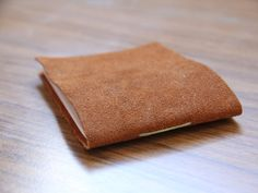 This is the perfect handmade gift for pretty much anyone in your life. Everyone could use a little notebook, right? And a soft, pretty leather one is all the better! Here is what you'll need: Piece of leather – you can get small pieces at most craft stores. Paper Scissors Waxed thread or string Awl …