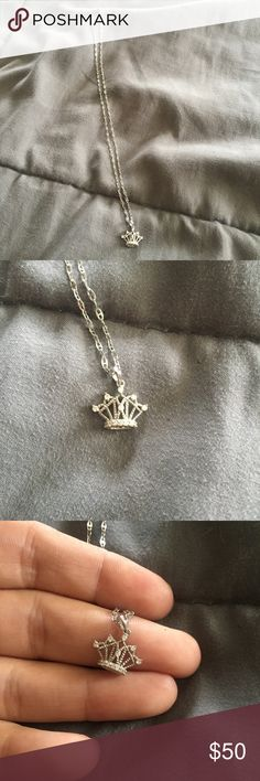 10K white gold 14 inch chain with crown charm 10K white gold chain with crown charm. I'm unable to see if charm has stamp of type of metal and not sure if stones are real or not. 14-inch white gold chain (see pic with stamp). Jewelry Necklaces