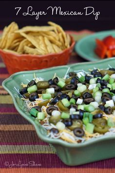 This 7-Layer Mexican Dip Recipe makes a great Game Day Recipe or the perfect dish to bring to your next potluck!