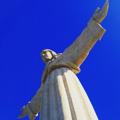 The Welcoming Christ. Inspired by Christ the Redeemer statue of Rio de Janeiro, in Brazil, this hallmark of Lisbon's South Bank  was built to express gratitude because the Portuguese were spared the effects of World War II. #christtheking #statuary #antoniolino #lisbon #iconography #architecture #lisbonsouthbank #gratitude  #history #lisbontailoredtours #lisbonwithpats