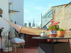 #Barcelona apartment: Born Terrace. Upstairs you have the daddy of all private roof terraces! Decked out with a marquee, hammock and bar, you really couldn't ask for more. Just grab the sunnies, sun lotion and holiday reading. You're in heaven!
