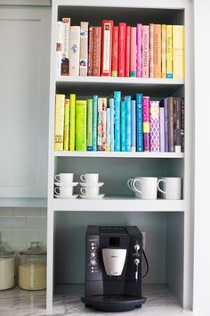 Colorful organized cookbooks: http://www.stylemepretty.com/living/2016/01/14/dreamy-kitchen-remodel-with-stove-that-takes-center-stage/