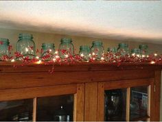 Kitchen Decor 21 Insanely Genius Ideas To Decorate The Kitchen In Christmas Spirit For Free - Have you started with decorating the homes for the Christmas and the upcoming holidays? If not, it is certainly time to start to think about how to Mason Jars, Mason Jar Kitchen, Pot Mason, Mason Jar Crafts, Canning Jars, Above Cabinet Decor, Decorating Above Kitchen Cabinets, Above Cabinets, Inset Cabinets