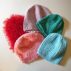Chemo caps to knit, crochet and sew. Tons of advice and tips for making. Image: 5 chemo caps made by the author; one is crocheted, the others are knitted