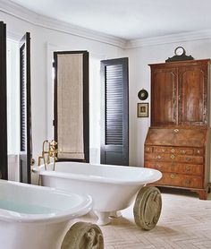 Adding custom cabinetry isn't the only option for bathroom storage. If you can swing it, a freestanding piece like this gorgeous secretary in Darryl Carter's DC townhouse makes a unique, outside-the-box statement in a bathroom.