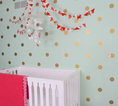 Gold polka dot wall decals in this #babygirl #nursery!