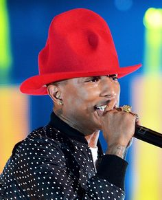 Pharrell Williams' Rainbow of Vivienne Westwood Hats - Red from #InStyle