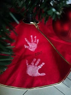 handprints on tree skirts fun Christmas tradition.  Add:  do this on Christmas day each year after all the presents are opened and mess cleaned.  Then will have time to dry before being stored.  Embroider date.