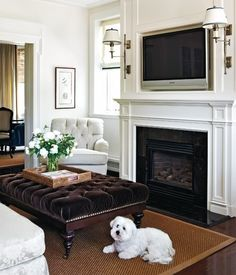 Style at Home: Traditional family room with windows covered in grosgrain roman shades flanking ...