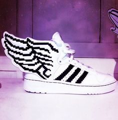 the best attitude e8568 6348a Pixelated Winged sneakers from Jeremy Scott for Adidas.