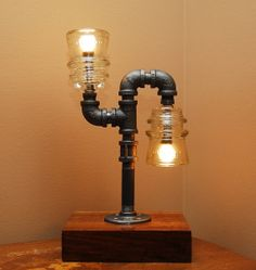 Industrial Style Pipe Lamp with Clear Glass by TRoweDesigns, $179.95 for @Sandra Smith.  These are glass insulators