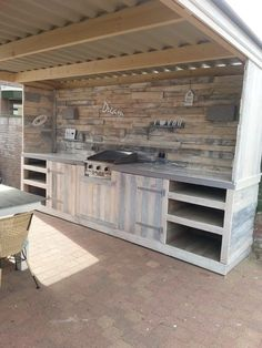 PERFECT!! I know its a table across from the oven, but if you just put more counter space right there with a sink, some hanging pots and pans, than this would be the perfect outdoor canning kitchen!