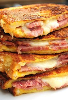 Monte Cristo Sandwiches. The best ham and cheese sandwiches. Strawberry jam and powdered sugar on top are a must!
