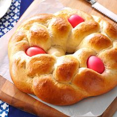 Easter Egg Bread Recipe -I've made this Easter treat for 20 years! Colored hard-cooked eggs baked in the dough give this sweet bread such a festive look. Leave them out and it can be enjoyed anytime of year. My husband especially enjoys this bread with baked ham. -Heather Durante, Wellsburg, West Virginia