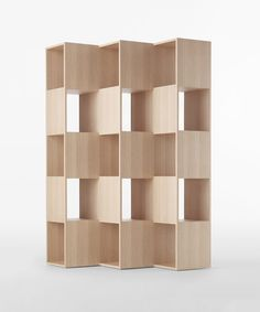 Fold is a minimalist design created by Tokyo-based design firm, Nendo. The shelving unit is composed of interlocking wooden boards that are oriented in different positions. The Japanese manufacturer Conde House is responsible for its manufacture. The boards seamlessly melt together as if there is no origin or end to where the construction begins. (5)