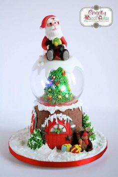 My first ever Christmas themed cake was made for my daughter's school Christmas Fair. It was a fun to make and the family almost didn't want to part with it. They said we can display it at home as a Christmas decoration. Mini Christmas Cakes, Christmas Themed Cake, Christmas Cake Decorations, Fondant Decorations, Christmas Sweets, Holiday Cakes, Christmas Goodies, Christmas Baking, Christmas Fun