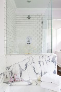 Grays Lane: Chic master bath with seamless glass shower and subway tile shower surround with ...