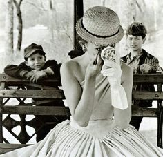 Girl is doing her make up. Vintage photo.